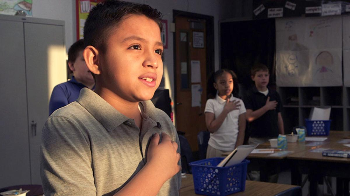 "A student pledges allegiance to the flag in ""American Creed,"" a PBS documentary that profiles citizen-activists around the country."