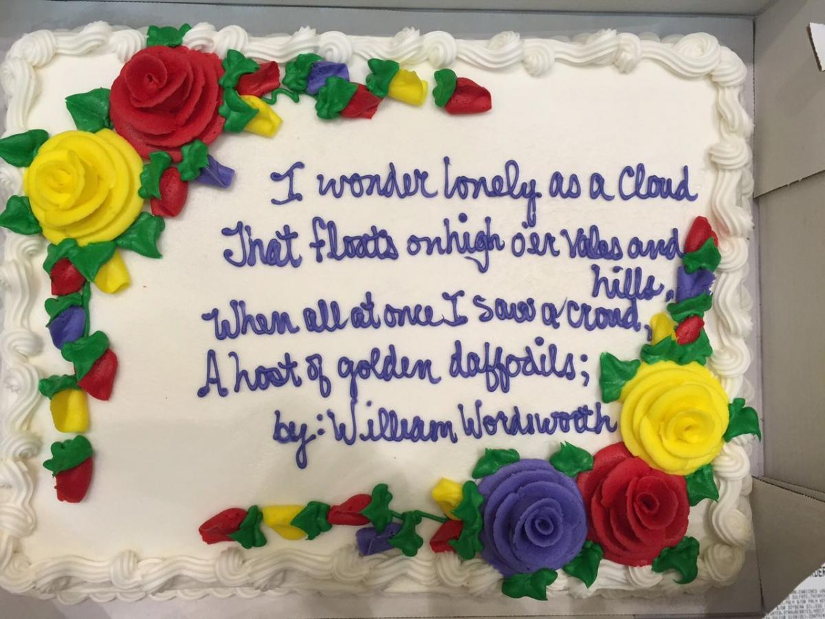 sheet cake with a poem written in icing