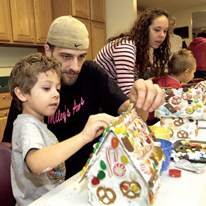 "The community cleans out its cupboards to supply building materials for ""gingerbread"" houses."
