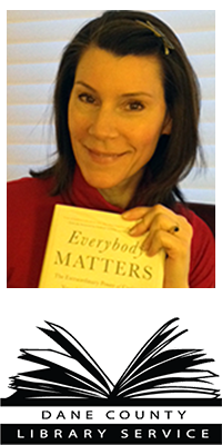"Headshot of Tracy holding a book that says ""Everybody Matters"""