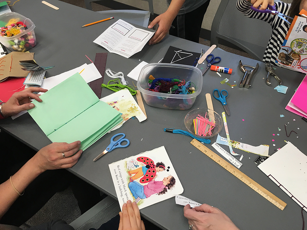Library Scouts work on creating their own books in the library.