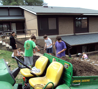 Students work on creating an organic vegetable garden outside the library.