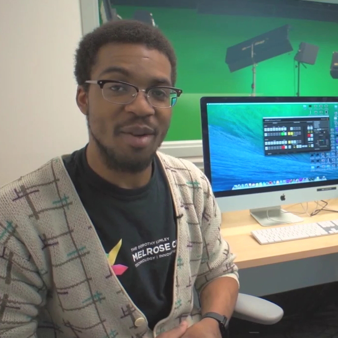 Orlando Public Library employee in front of computer monitor - shot from video