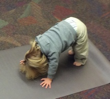 toddler doing down dog pose
