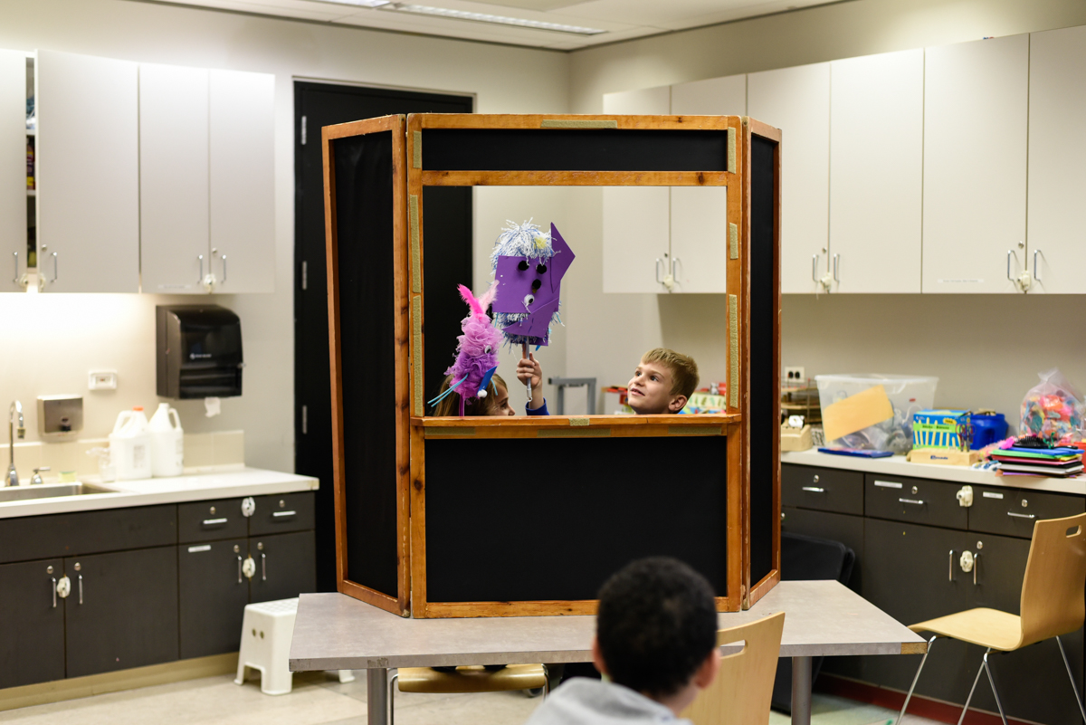 Kids putting on a puppet show