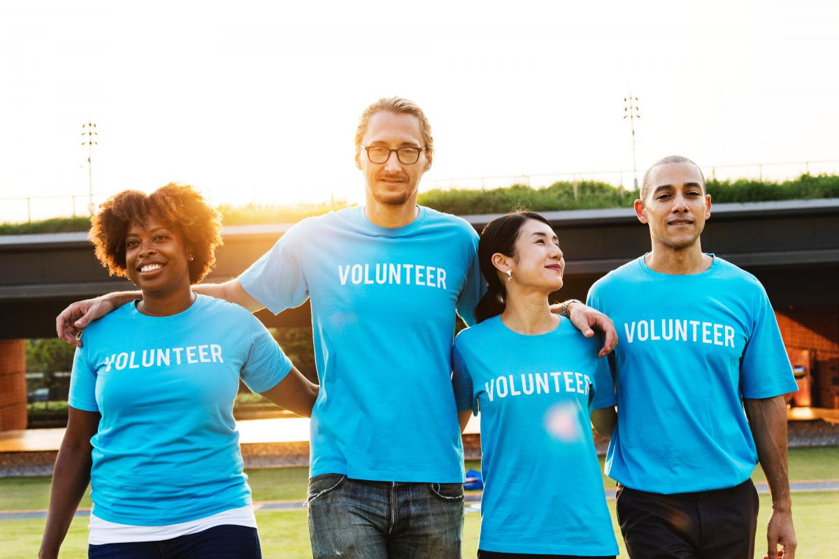 "A group of people wearing ""volunteer"" t-shirts"