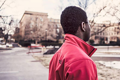 Young man looks out over street