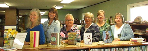 A group of women lined up in a library