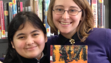 "A librarian and a student hold a copy of ""March: Book One"""