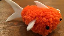 Pom-pom made to look like a fish