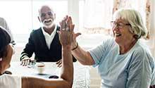 Older adults touching palms