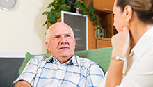 Older adult speaking to advisor