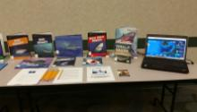 Display of books about sharks and a laptop