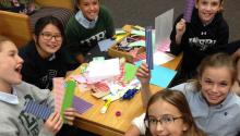 Girls making bookmarks
