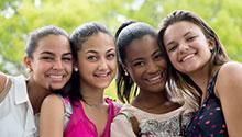 Group of teenage girls smiling