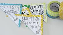 These page-corner bookmarks serve as a colorful reminder to keep reading.