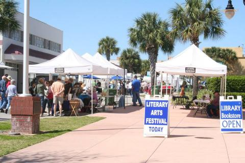 Tents and patrons at the Literary Arts Festival