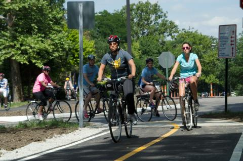 Cyclists at the University of Dayton on a city bike path