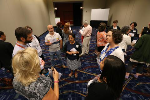 Librarians standing in a circle at a workshop at the ALA Annual Conference.