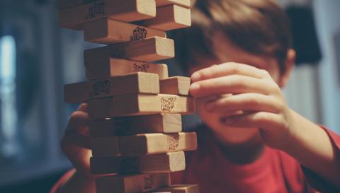 A child playing Jenga