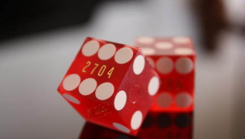two red dice lay on a table