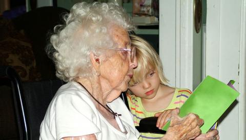 Granddaughter and grandmother reading together