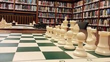 chess board with books in the background