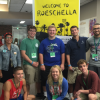 Group of first year students post at the Roeschella sign