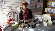 A vendor selling her crafts