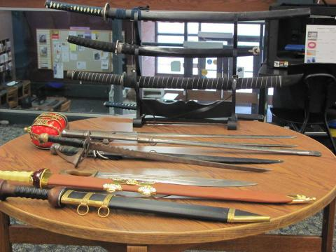 A weapons exhibit shows off various swords.
