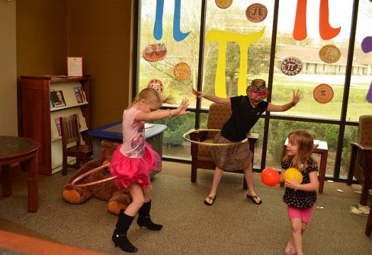 Kids using hula hoops for circle play