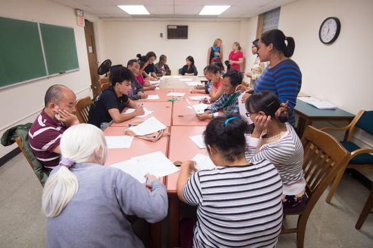 Nepali and Burmese-speaking patrons learn about financial literacy.