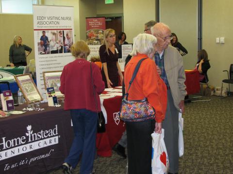 Patrons looking at display at Senior Expo
