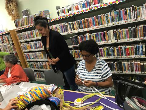 Women knitting the plarn