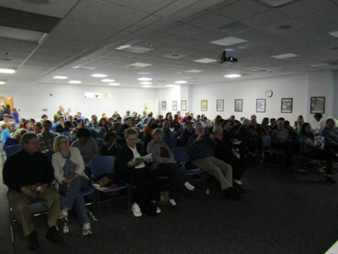 Packed house for a presentation, view from front