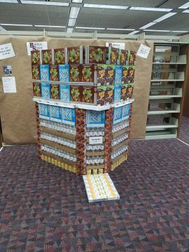 A building made from bottled water and cereal boxes.