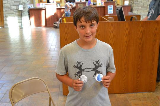 Pokethon participant shows off badges