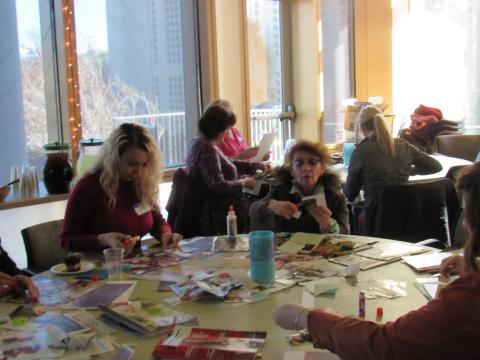 Patrons work on constructing their vision boards.