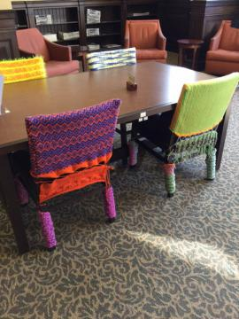 Crocheted chairs around table