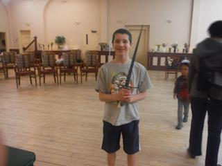 Kid stands with sword