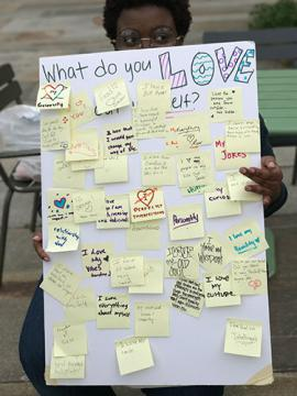 """Post-it wall asking """"What do you love about yourself?"""" with responses"""