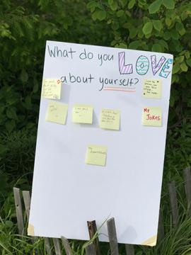 """Post-it wall asking """"What do you love about yourself?"""""""