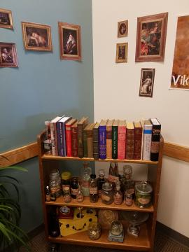 Shelves of books and potions