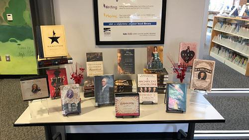 A display table featured a curated mix of fiction and non-fiction books about Hamilton and other Founding Fathers.