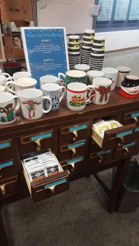 Card catalog used as tea and mug storage