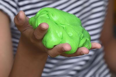 Child holding slime