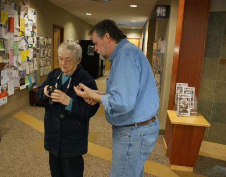 When older adults needed camera help, a teaching assistant and librarian were there to help.