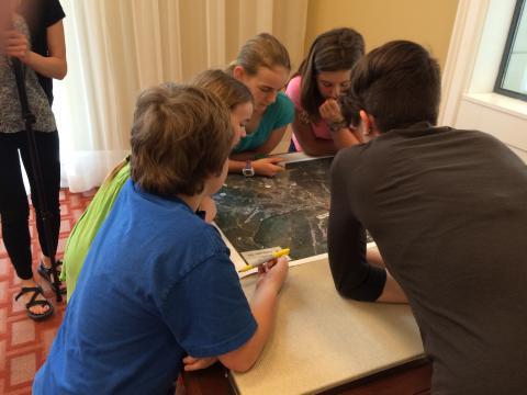 Group huddled around a map