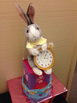 Stuffed white rabbit with watch decoration