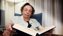 Old woman reading a book